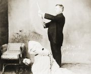 The subject of One Ahead, early 20th century magician David P. Abbott, beheads a lady.