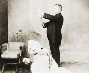 Early 20th century magician, David P. Abbott, beheads a lady.