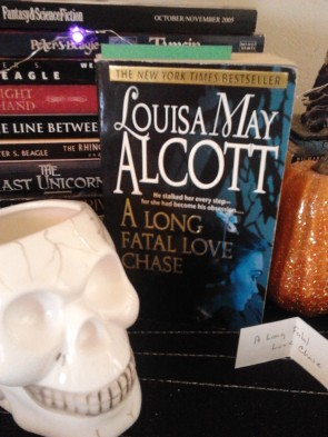"Skull TBR ""jar"" with paperback of A Long Fatal Love Chase"