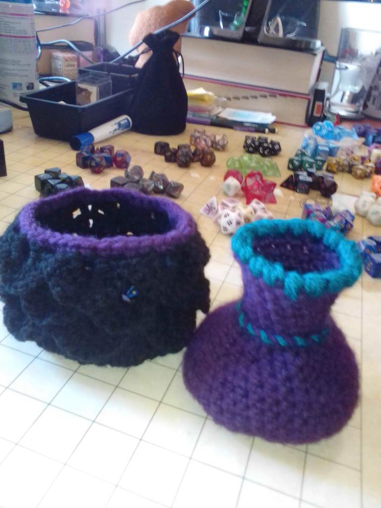 Two crocheted dice containers.
