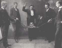 Picture of Joseffy, the magician, performing with his Talking Skull, Balsamo.